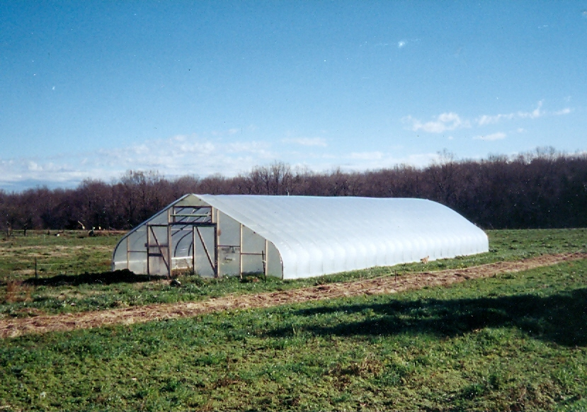 The 30' x 96' gothic-style hoophouse at Twin Oaks Community